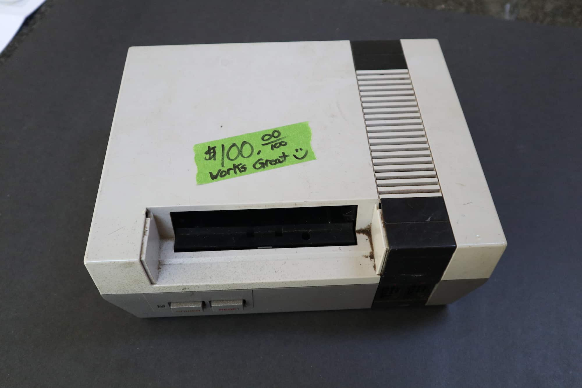 a picture of a garage sale nes system