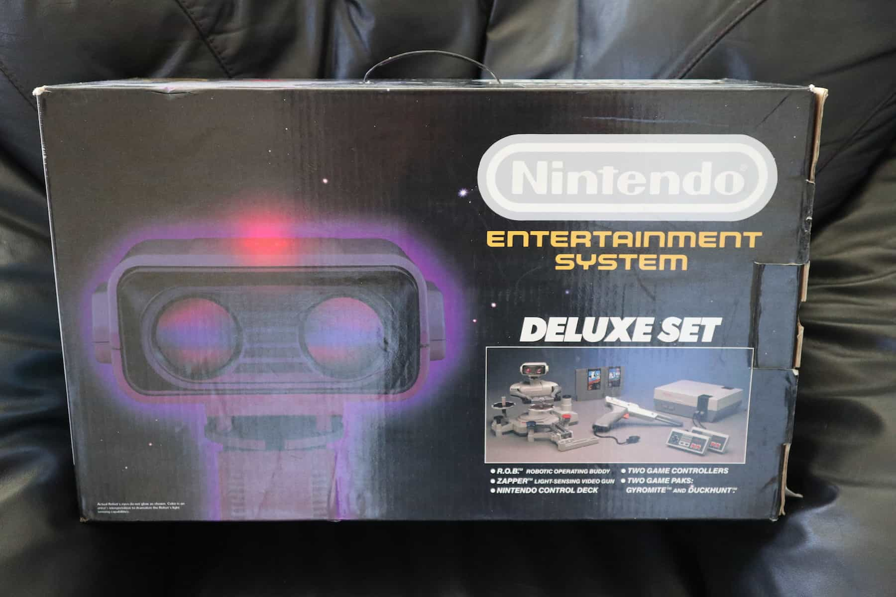 a picture of a 1985 original NES deluxe set complete