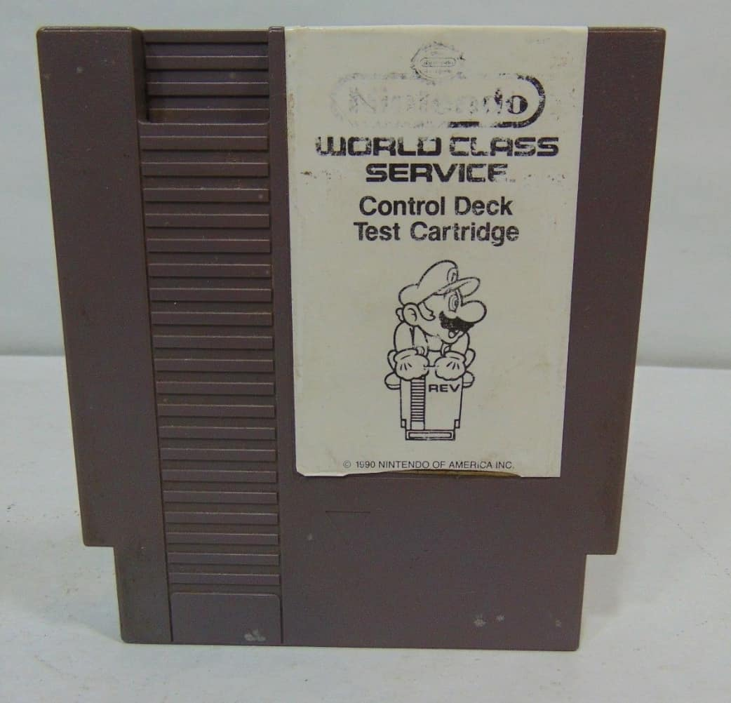A picture of a grey NES control deck test cartridge